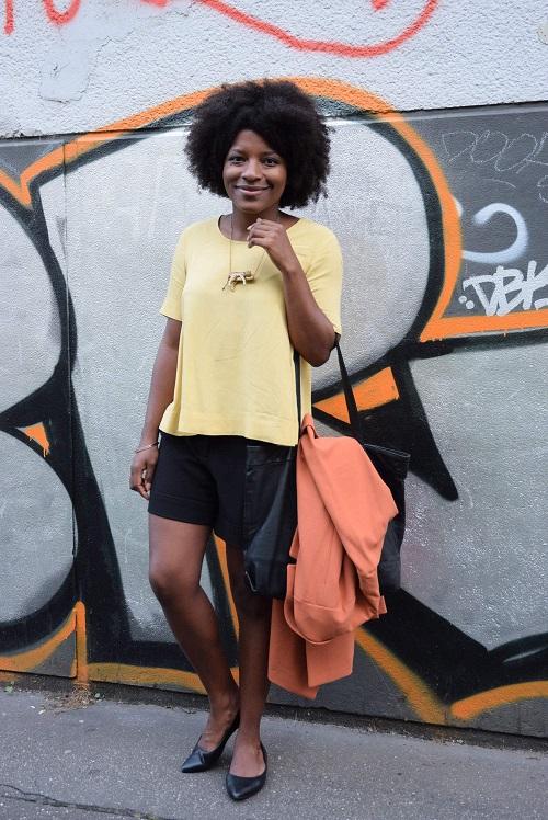 manteau orange cabas noir